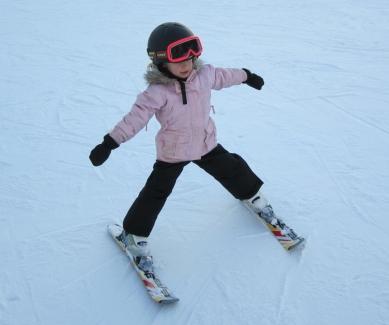Charlotte demonstrates the snowplough