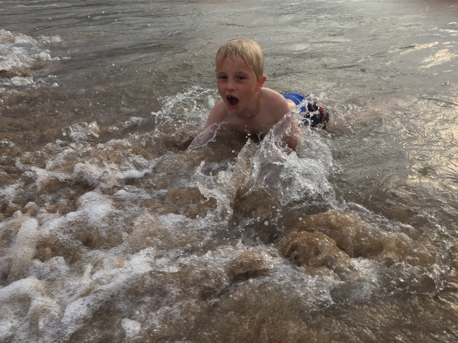 Playing in the surf at Voidokilia, Costa Navarino